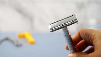 Use a Razor Blade Carefully to remove printer ink from paper