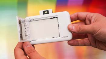 Insert a film pack into your polaroid printer